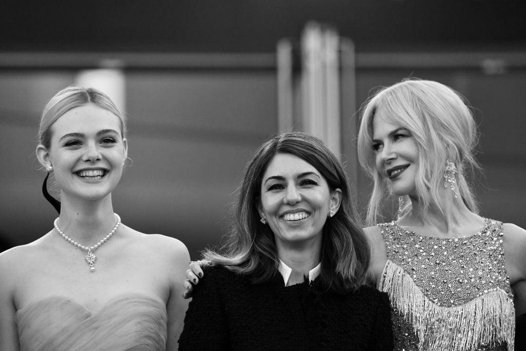 Elle Fanning, Sofia Coppola y Nicole Kidman  / AFP PHOTO / Alberto PIZZOLI