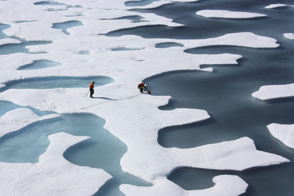 FILE PHOTO: The crew of the  U.S. Coast Guard Cutter Healy, in the midst of their ICESCAPE mission, retrieves supplies in the Arctic Ocean in this July 12, 2011 NASA handout photo.  Kathryn Hansen/NASA via REUTERS/File Photo   ATTENTION EDITORS - THIS IMAGE WAS PROVIDED BY A THIRD PARTY. EDITORIAL USE ONLY. NO RESALES. NO ARCHIVE.