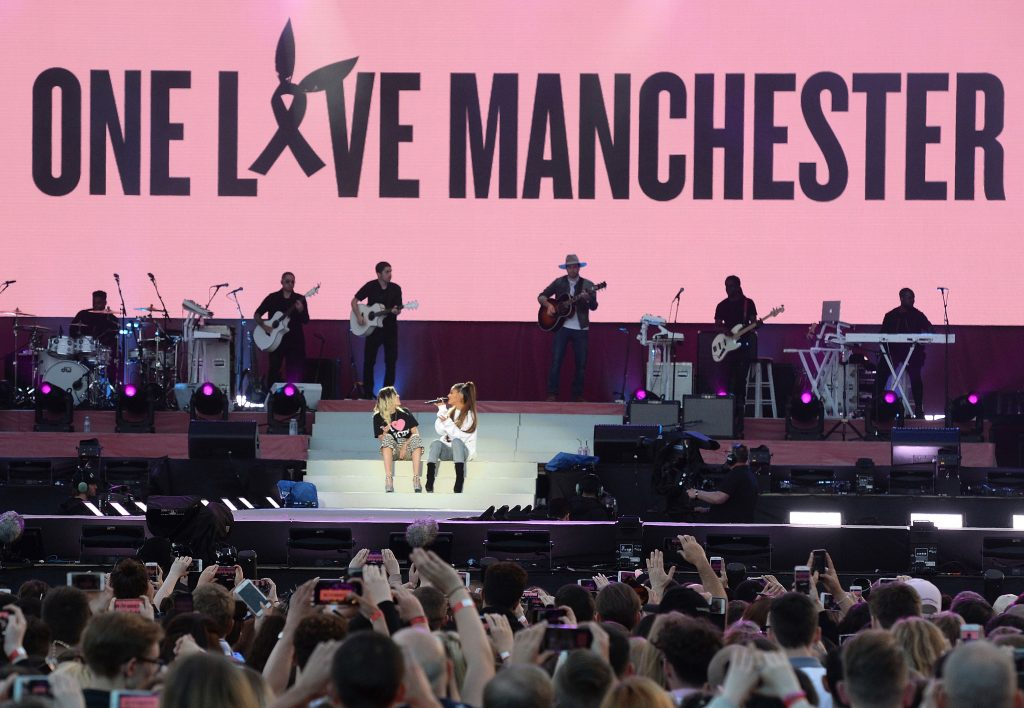 In this Sunday, June 4, 2017, handout photo provided by Dave Hogan for One Love Manchester, singers Ariana Grande, right, and Miley Cyrus perform at the One Love Manchester tribute concert in Manchester, north western England, Sunday, June 4, 2017. One Love Manchester is raising money for those affected by the bombing at the end of Ariana Grande's concert in Manchester on May 22, 2017. (Dave Hogan via AP)