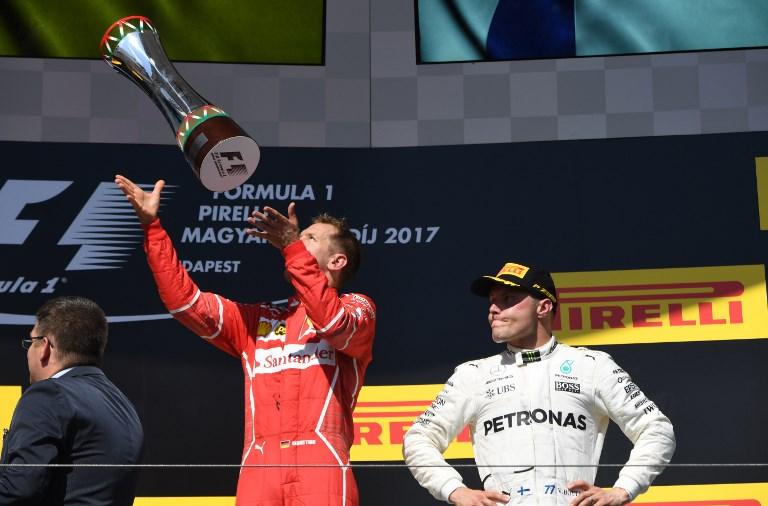 El alemán Sebastian Vettel (Ferrari) amplió su ventaja como líder del Mundial de Fórmula 1 al ganar este domingo el Gran Premio de Hungría. @AFP