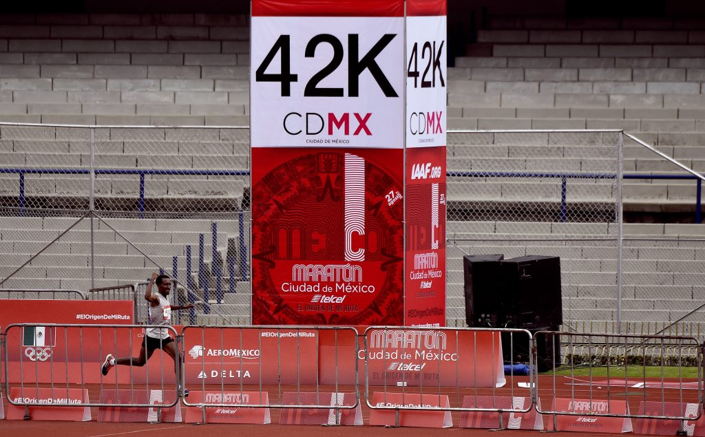 Ethiopian runner Fikadu Kebede heads to the finishing line to win Mexico City International Marathon, at the Olimpic Universitary stadium on August 27, 2017.  Kebede won with a time 2h 17' 32