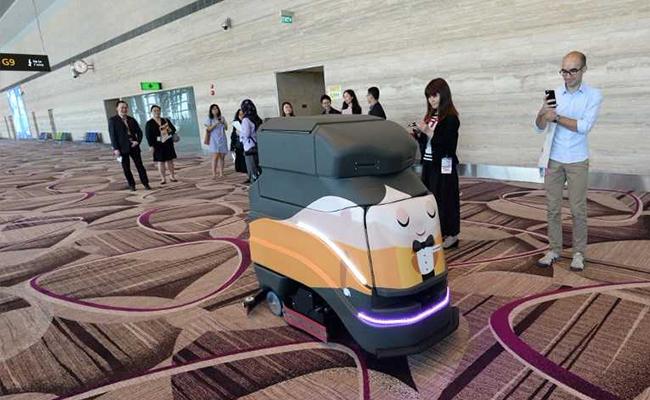Robot en aeropuerto de Singapur. @AFP
