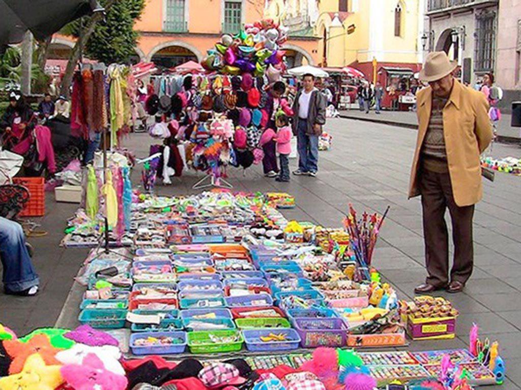 Economía informal en México bajó en 2016 en proporción a PIB