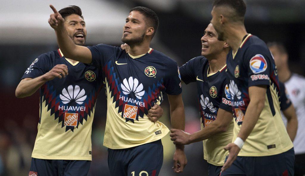 Las Águilas del América utilizaron a sus cinco refuerzos, incluído el francés Jérémy Ménez, para vencer 1-0 a los Rojinegros del Atlas, en el debut de Rubén Omar Romano como técnico de los Zorros