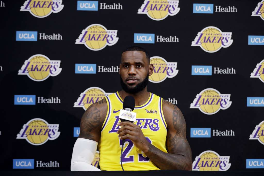 Los Angeles Lakers' LeBron James fields questions during media day at the NBA basketball team's practice facility Monday, Sept. 24, 2018, in El Segundo, Calif. (AP Photo/Marcio Jose Sanchez)
