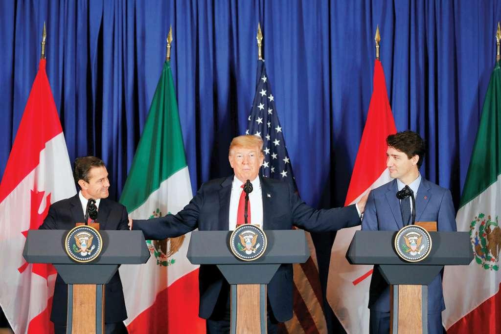 TRATADO. El presidente de México, Enrique Peña; de EU, Donald Trump; y el primer ministro de Canadá, Justin Trudeau, firmaron el acuerdo comercial T-MEC, en el marco del G20, en Argentina. Foto: Archivo/ Notimex