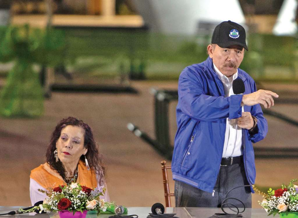 Nicaraguan President Daniel Ortega (R) speaks alongside Vice-President Rosario Murillo during the opening ceremony of a highway overpass in Managua, Nicaragua, on November 29, 2018. (Photo by Inti Ocon / AFP)