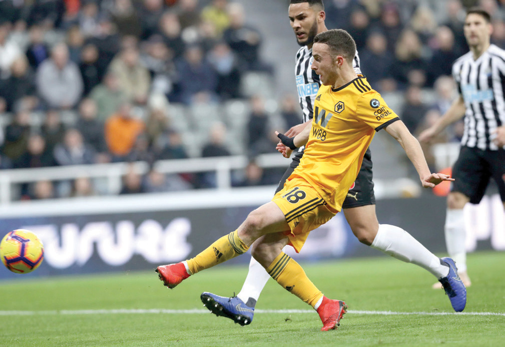 Wolverhampton Wanderers' Diogo Jota scores his side's first goal of the game against Newcastle United, during their English Premier League soccer match at St James' Park in Newcastle, England, Sunday Dec. 9, 2018. (Owen Humphreys/PA via AP)