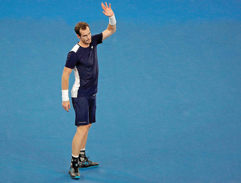 Britain's Andy Murray waves to the crowd after his first round loss to Spain's Roberto Bautista Agut at the Australian Open tennis championships in Melbourne, Australia, Monday, Jan. 14, 2019.(AP Photo/Mark Schiefelbein)