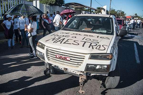 La CNTE denunció los atentados en contra de su libertad de expresión y de manifestación, ya que consideraron que esto se da mediante presiones judiciales que no contribuyen a solucionar la problemática educativa en la entidad.FOTO: CUARTOSCURO