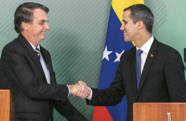 El presidente encargado de Venezuela, Juan Guaidó, se reunió ayer con el mandatario brasileño, Jair Bolsonaro.FOTO:AFP