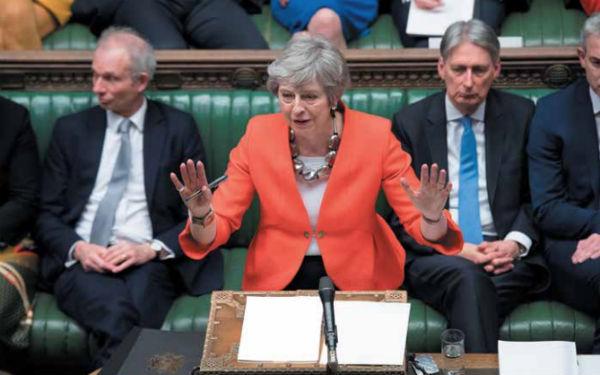 May sufrió su segunda derrota en el Parlamento británico, al ser rechazado su plan de salida del bloque. FOTO: AFP