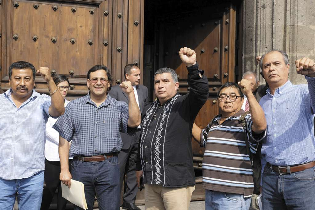Eloy López, Víctor Manuel Zavala y Enrique Enríquez infor - maron que se habló también de política.FOTO:CUARTOSCURO