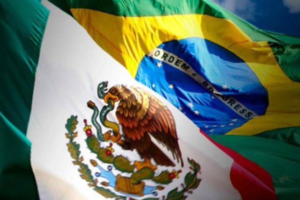 Banderas de México y Brasil. El Fondo Monetario Internacional (FMI) a rebajar hasta el 0,6 % la previsión de desarrollo de América Latina y el Caribe en 2019, ocho décimas menos que en su informe del abril. Foto: Especial