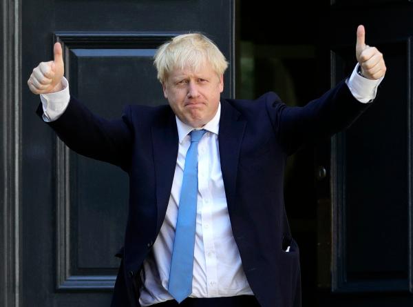 ELECTO. Boris Johnson, en el momento que llegó ayer a la sede del Partido Conservador. Foto: AP